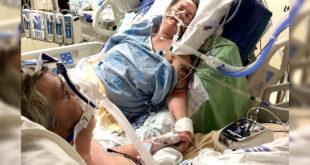 日前一名男子將父母在病床前的牽手照PO上網路,感動無數網友。(圖片來源:people)