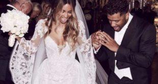 歌手席亞拉穿著繡滿精緻蕾絲的宮廷式婚紗,與美式足球明星球員威爾森結為連理。(圖片來源/翻攝自網路)