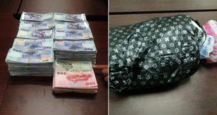 民眾拾獲的剩餘贓款,用黑色塑膠袋包裹。(圖片來源:警方提供)