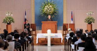 懷恩堂19日上午舉行周聯華牧師追思禮拜,現場滿人,但氣氛莊重肅穆。  圖片來源:世界展望會提供