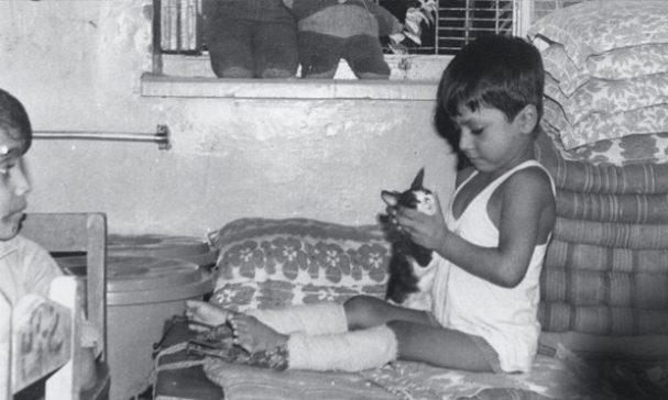 路易士雙腿癱瘓,被親生父母拋棄最後到來到育幼院。(圖片來源:CNN)