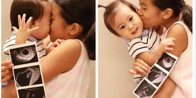 賈靜雯在臉書貼出梧桐妹抱咘咘合照,宣布懷孕。(圖片來源/翻攝至賈靜雯臉書)